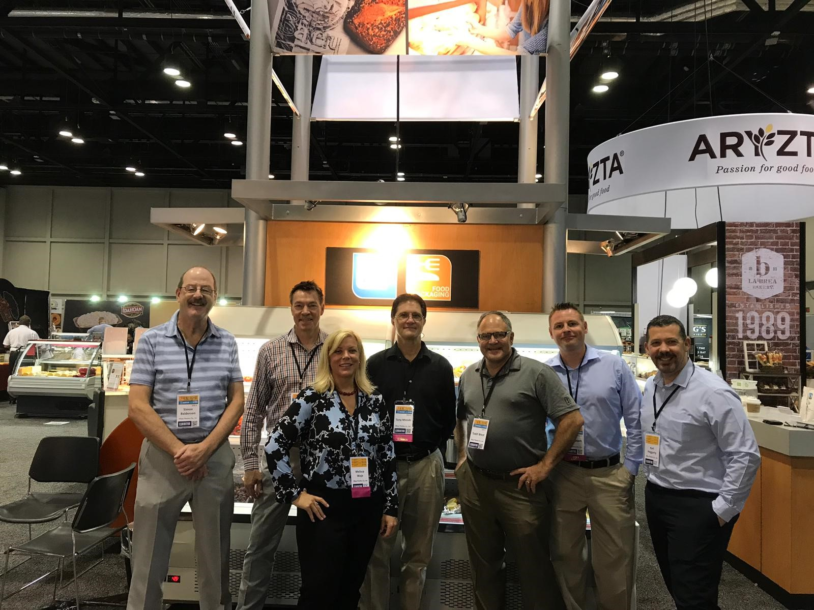 Simon Balderson, left, and Karl Heggarty, right, with the Elkay team at IDDBA